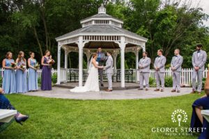 wedding party under garden gazebo
